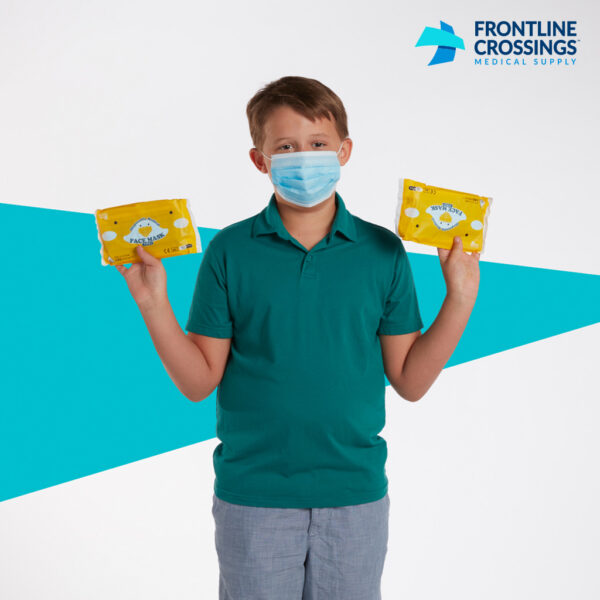 kid holding masks in packaging